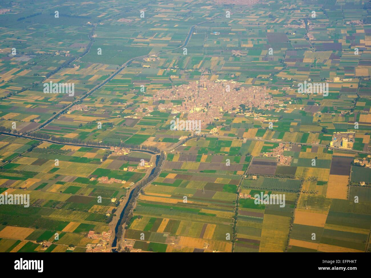Aerial of suburbs of Cairo with a little channel for irrigation, Egypt, North Africa, Africa - Stock Image