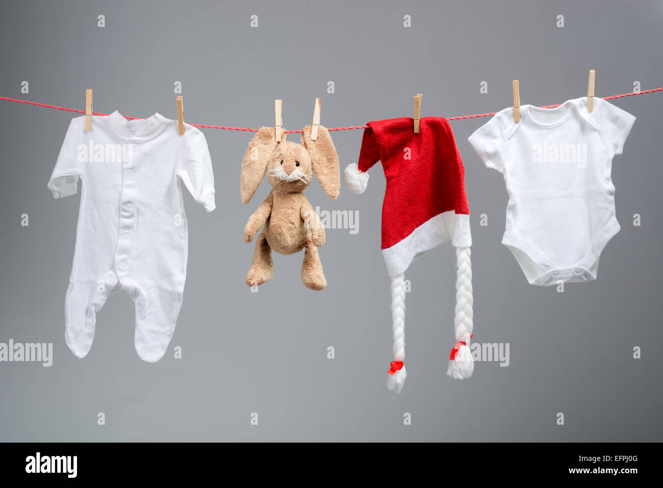 Baby Clothes And Santa Hat On A Clothesline Stock Photo 78558384