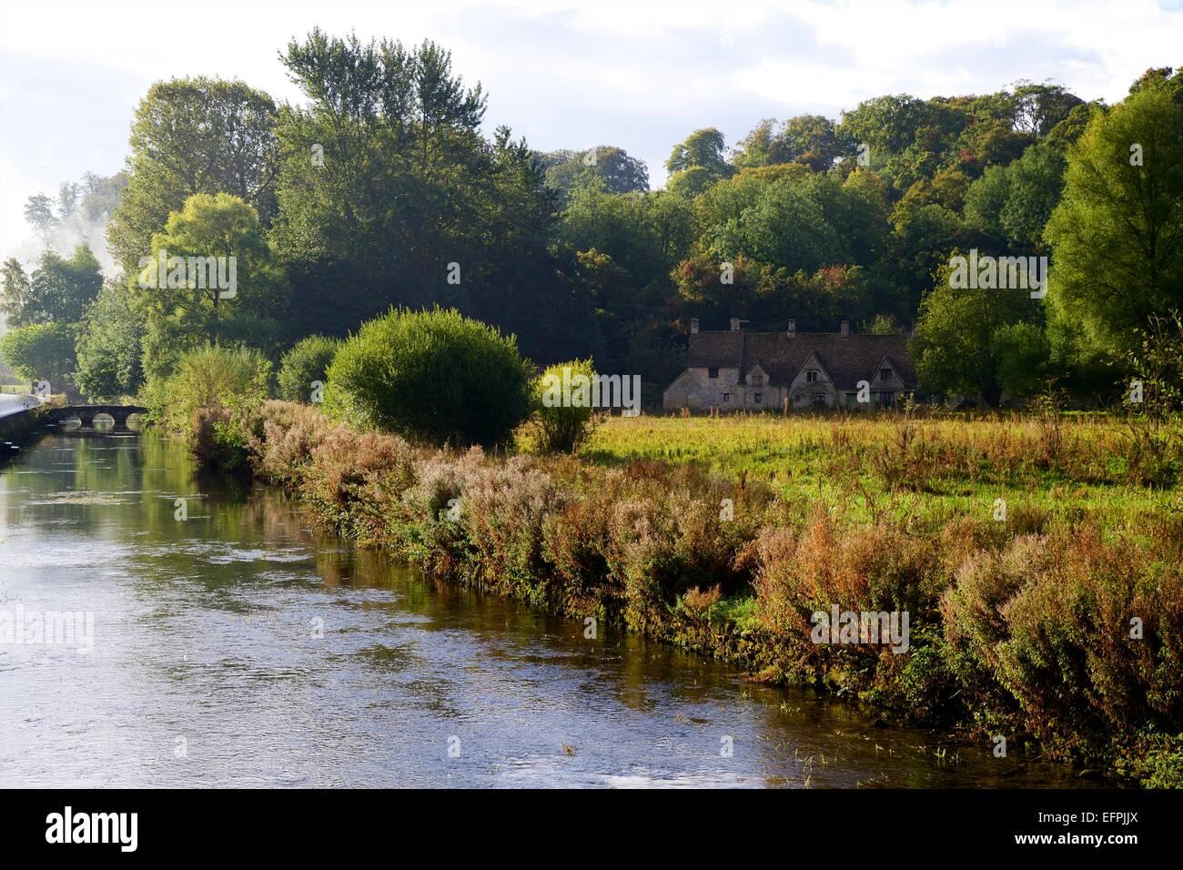 River Coln and Arlington Row, Bibury, Cotswolds, Gloucestershire, England, United Kingdom, Europe - Stock Image
