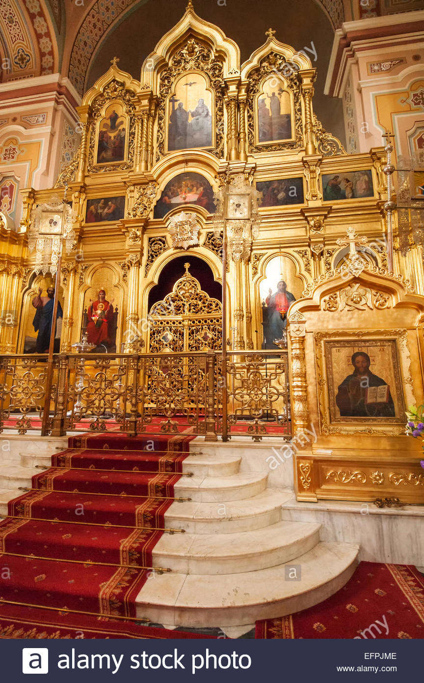 Carpeted stairs leading to gold atlar of the Maria Magdalena Polish Orthodox Cathedral, Praga district, Warsaw, - Stock Image