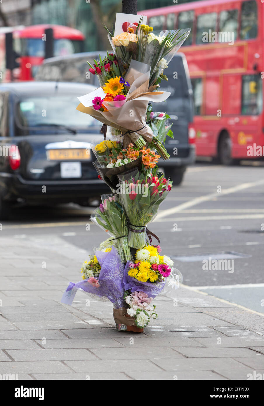 Floral tributes left at the scene of a fatal cyclist accident in central London - Stock Image