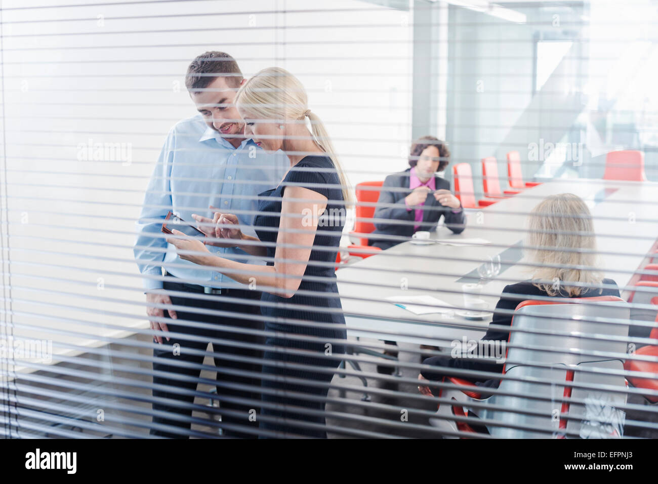 Colleagues using digital tablet - Stock Image