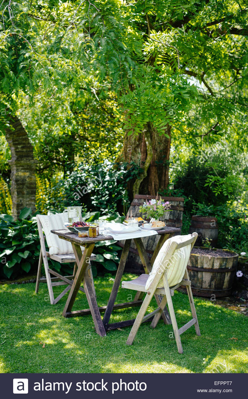 Table for two in garden - Stock Image