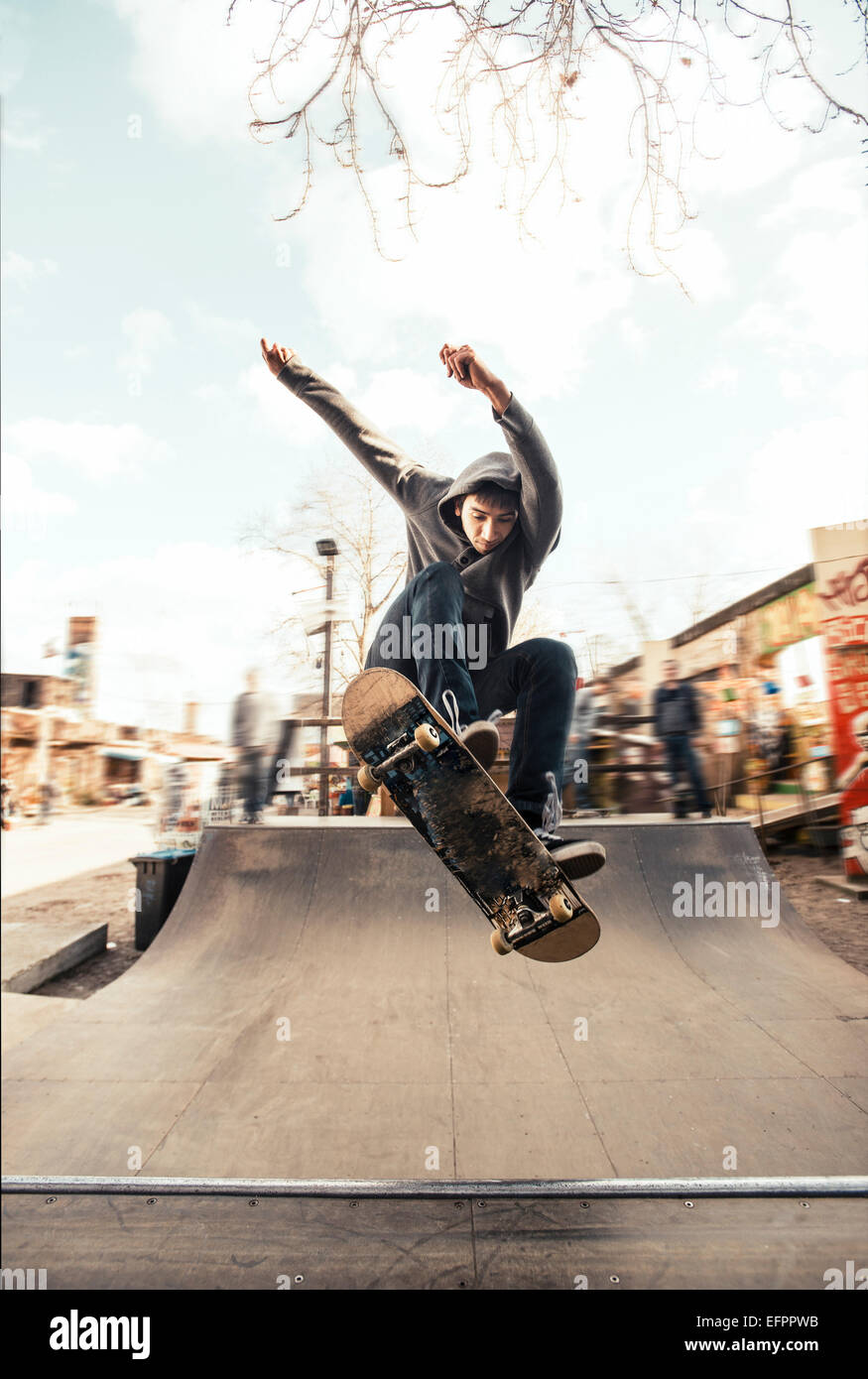Skateboarding on mini ramp, Frontside nollie heelflip, Berlin, Germany - Stock Image