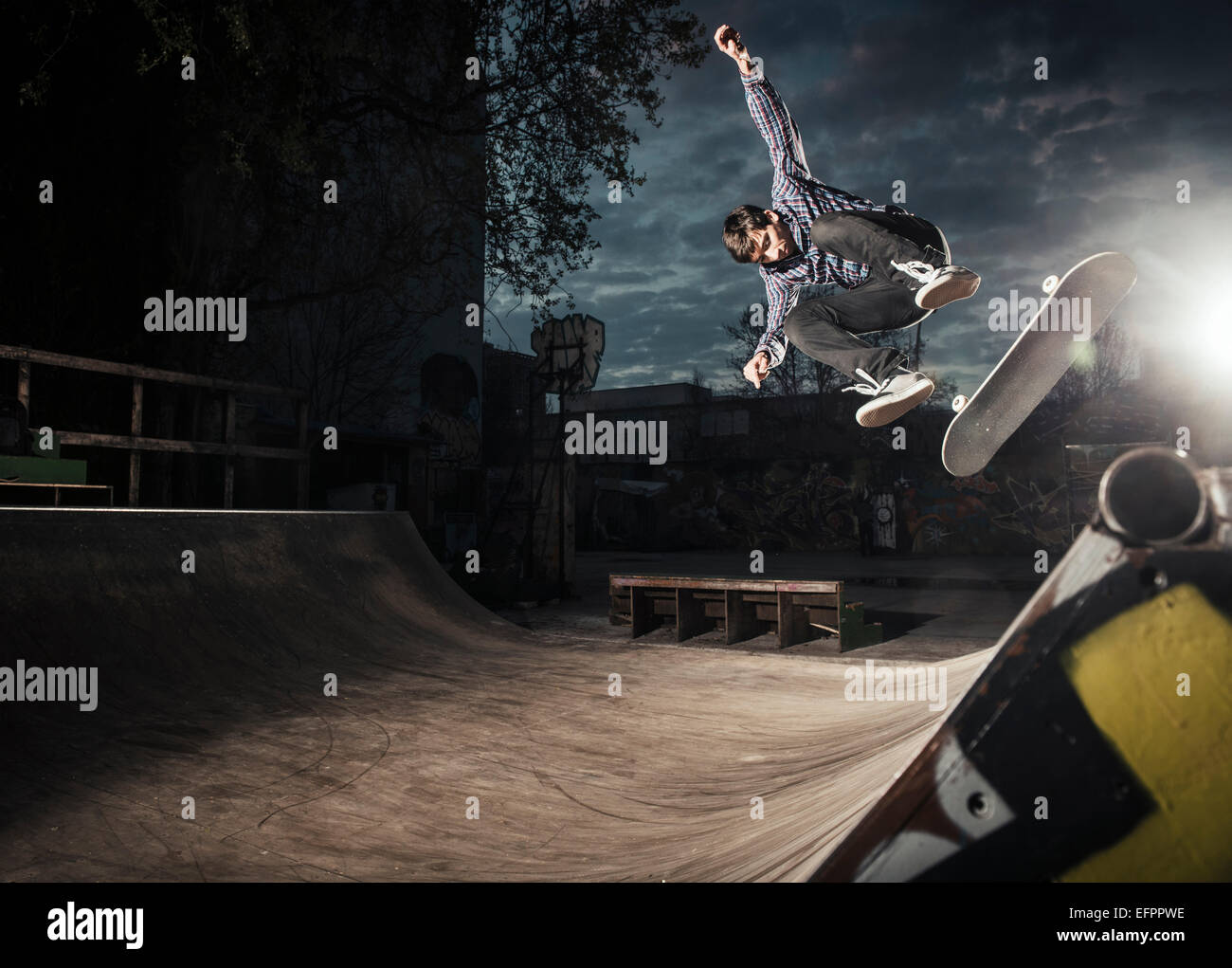 Skateboarding on mini ramp, Bigspin flip, Berlin, Germany - Stock Image