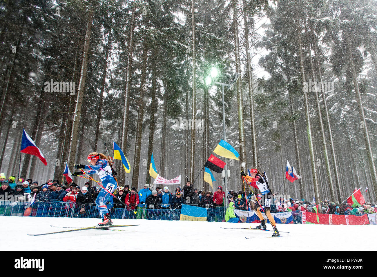 Czech racer Gabriela Soukalova (left) and Vanessa Hinz from Germany compete in the women's 10 km pursuit race - Stock Image