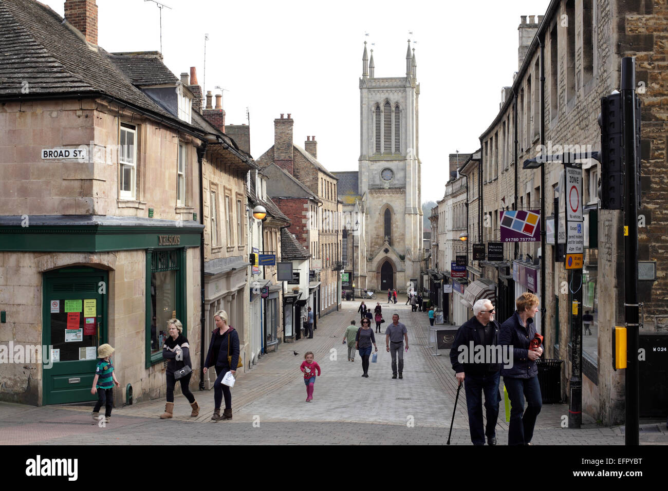 Looking down Iron-monger Street, Stamford, Lincolnshire. towards St Michael's Church. - Stock Image