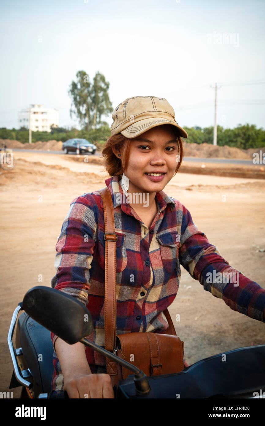 Portrait of a young woman on a scooter outside Siem Reap, Cambodia. - Stock Image
