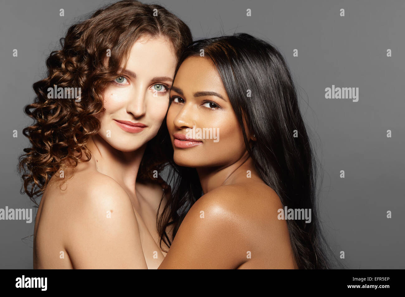 Female models hugging - Stock Image