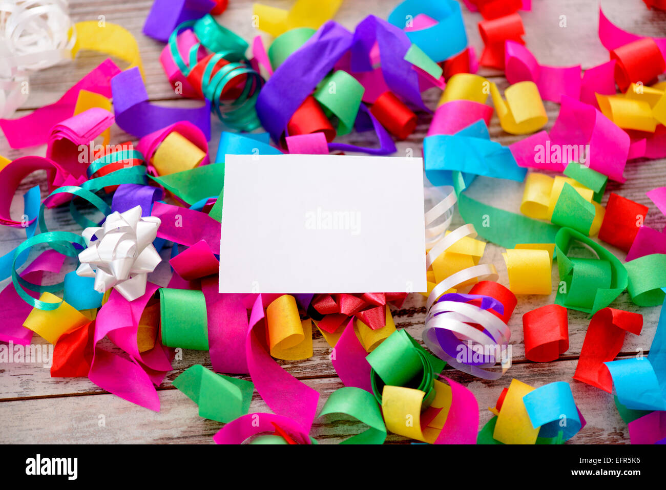 Greeting card in the pile of confetti - Stock Image