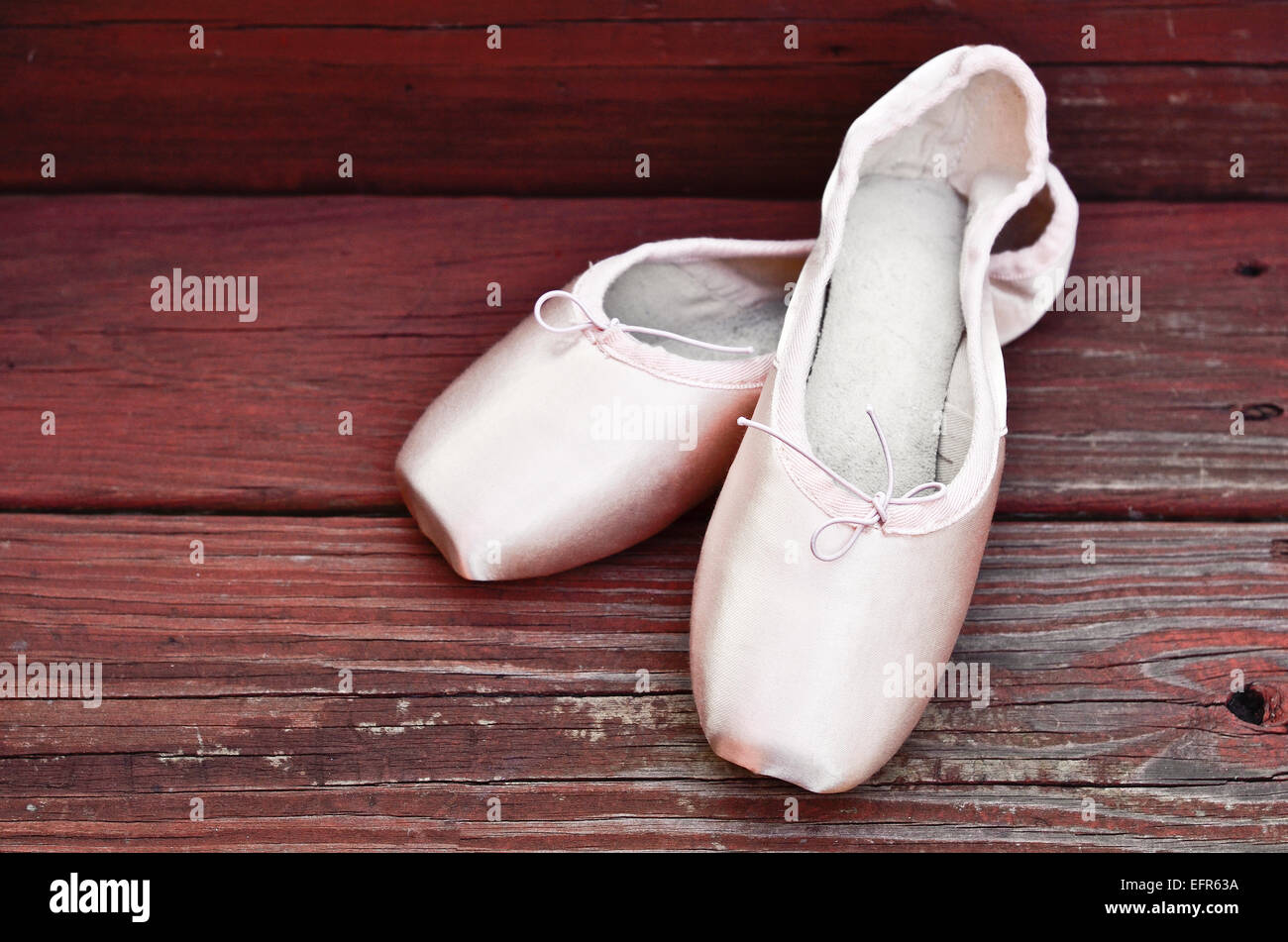 ballet shoes on a wooden floor - Stock Image
