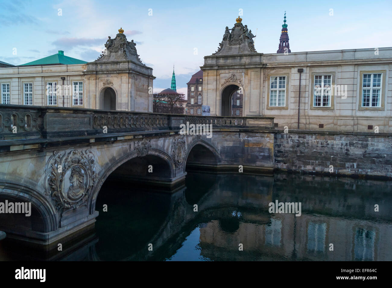 Marmorbroen (Marble Bridge) over Frederiksholms Canal with Christiansborg Palace in the background, Copenhagen, Stock Photo