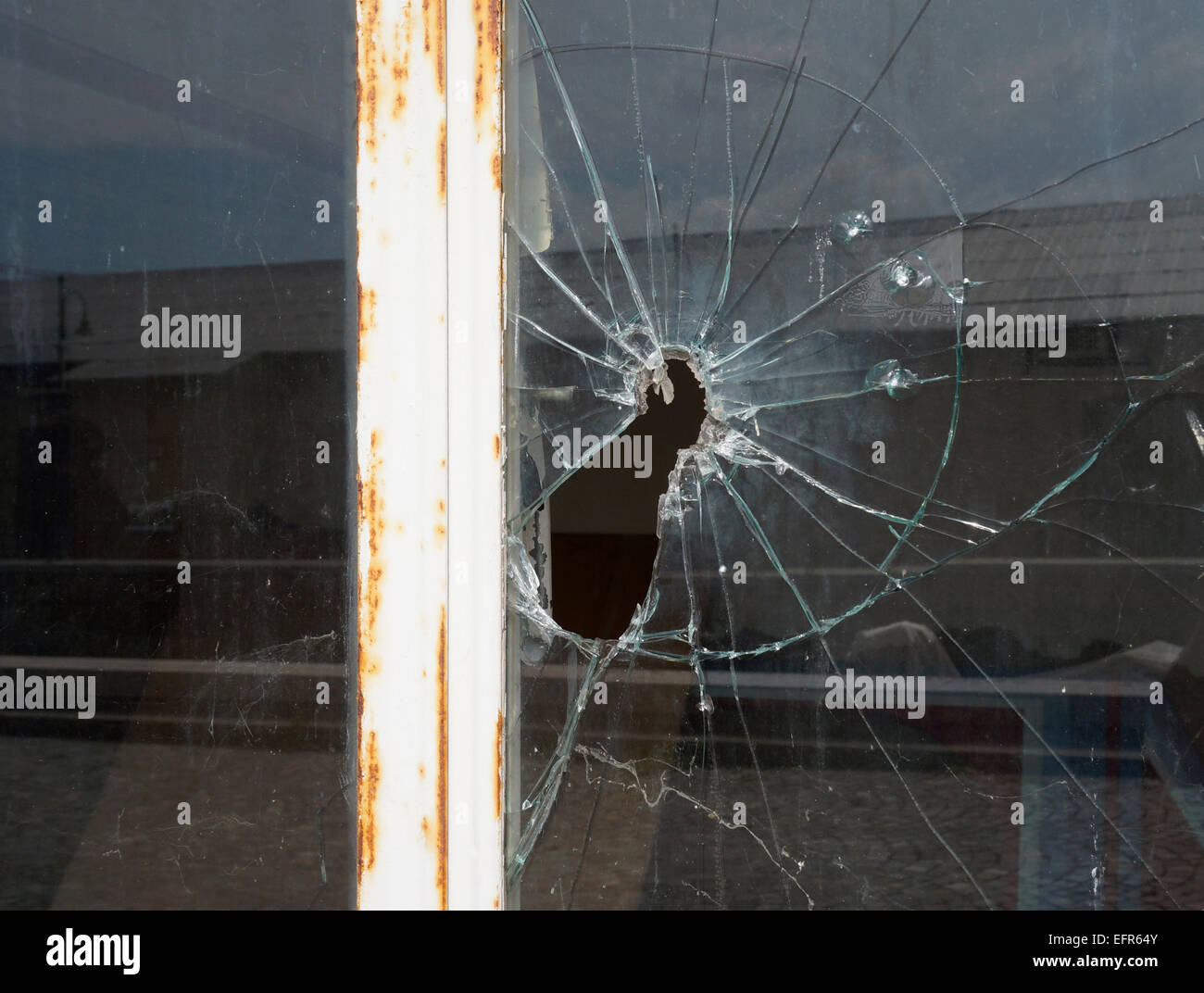 shattered and broken glass of a window - Stock Image