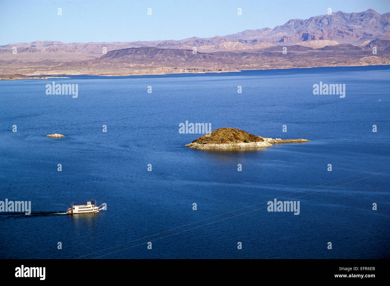 A tour boat plies Lake Mead, Nevada, USA. - Stock Image