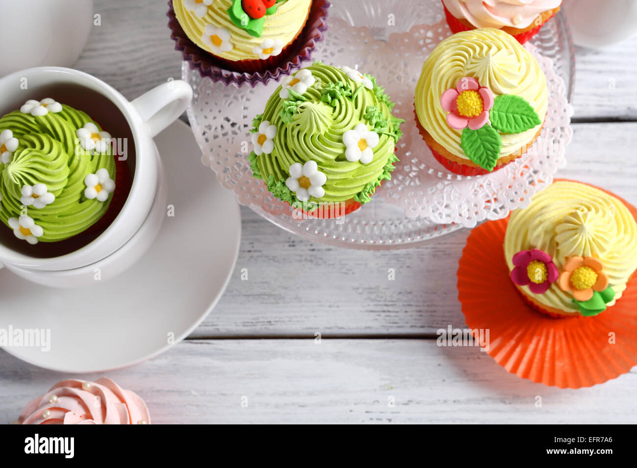Beautiful Easter Cupcakes, festive table top view - Stock Image