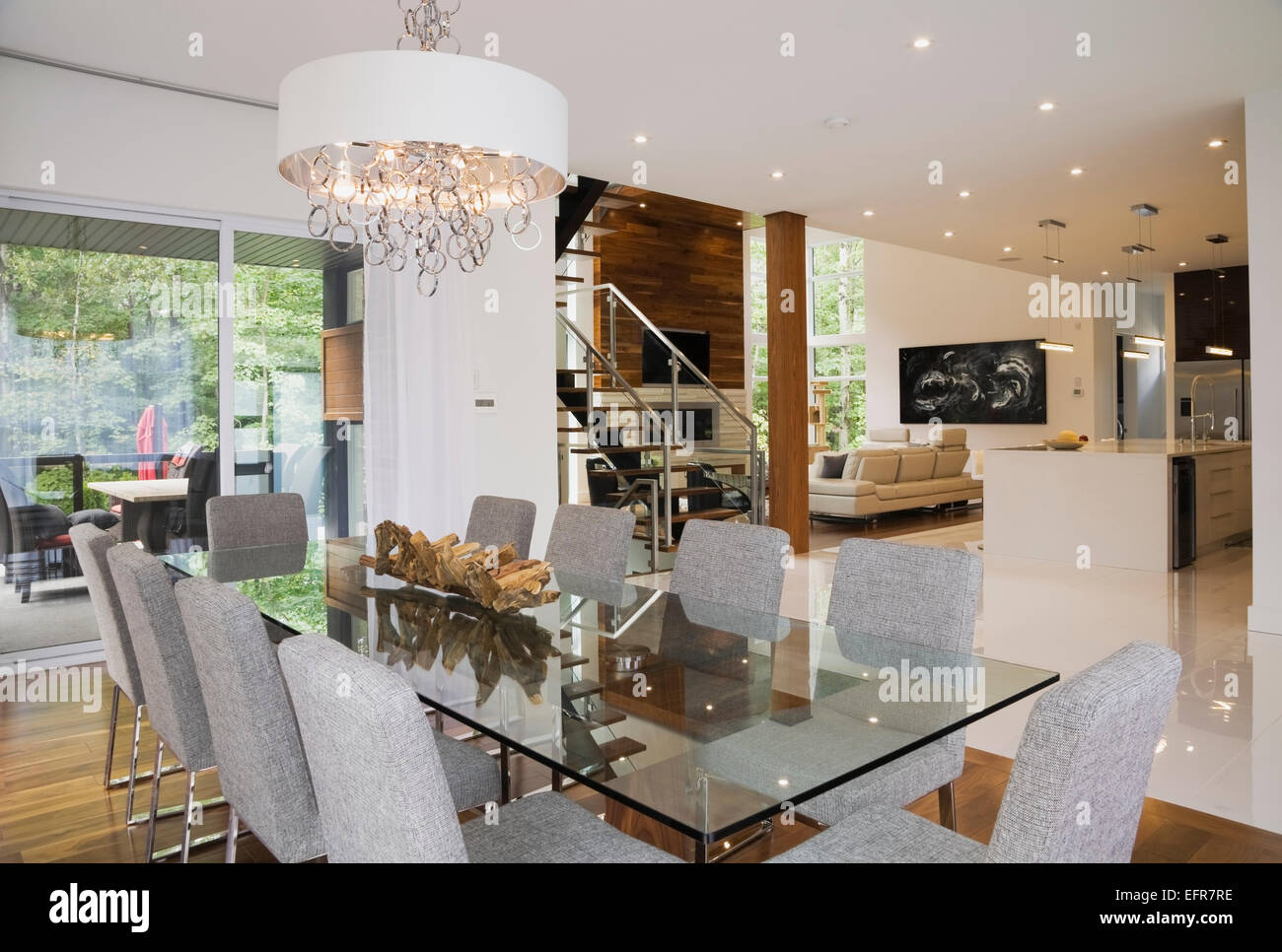 Modern Interior Design Luxury Open Plan Dining Room With Glass Table And Grey Upholstered Chairs