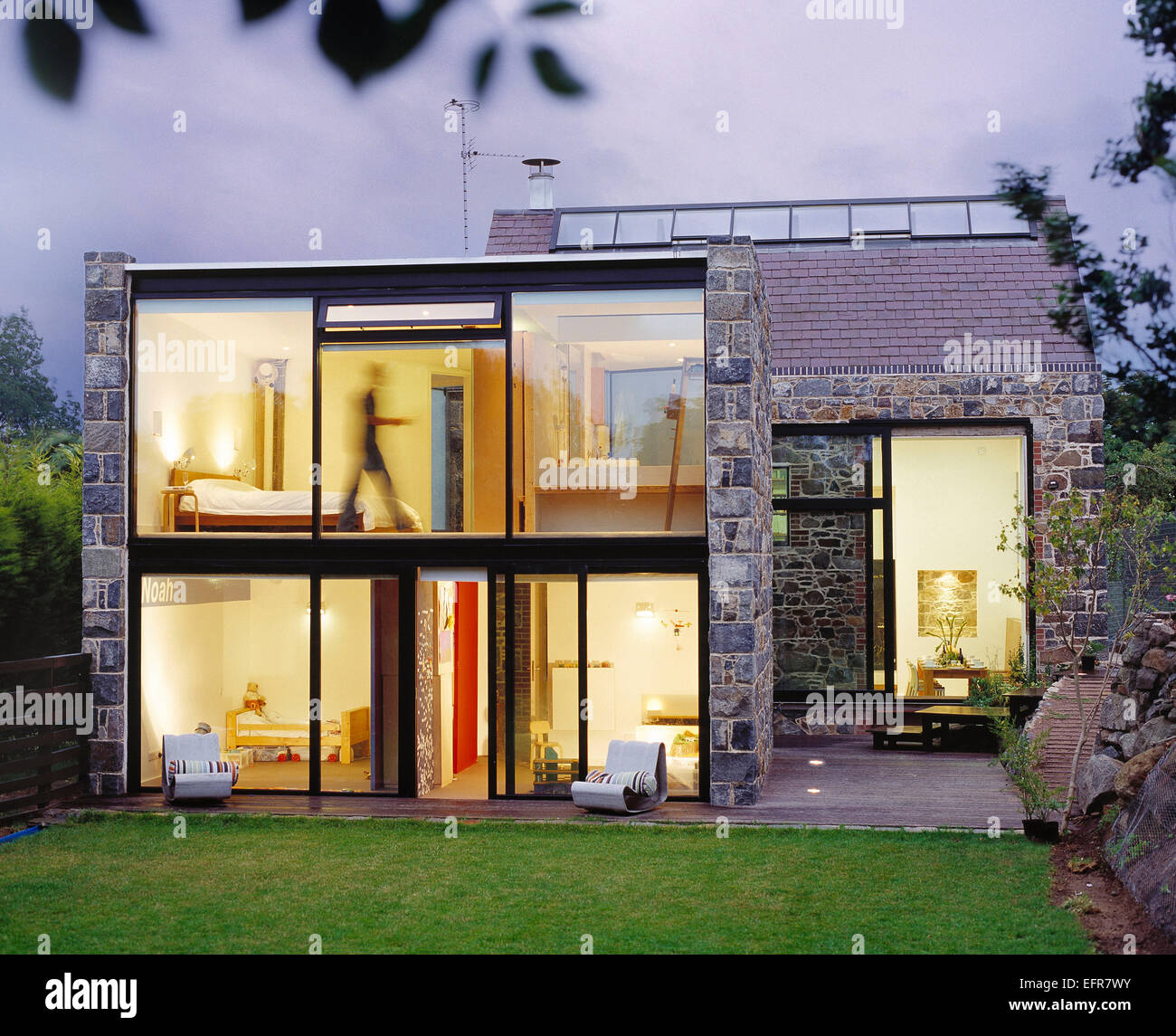 Architecture. Modern house exterior at dusk. Guernsey. - Stock Image