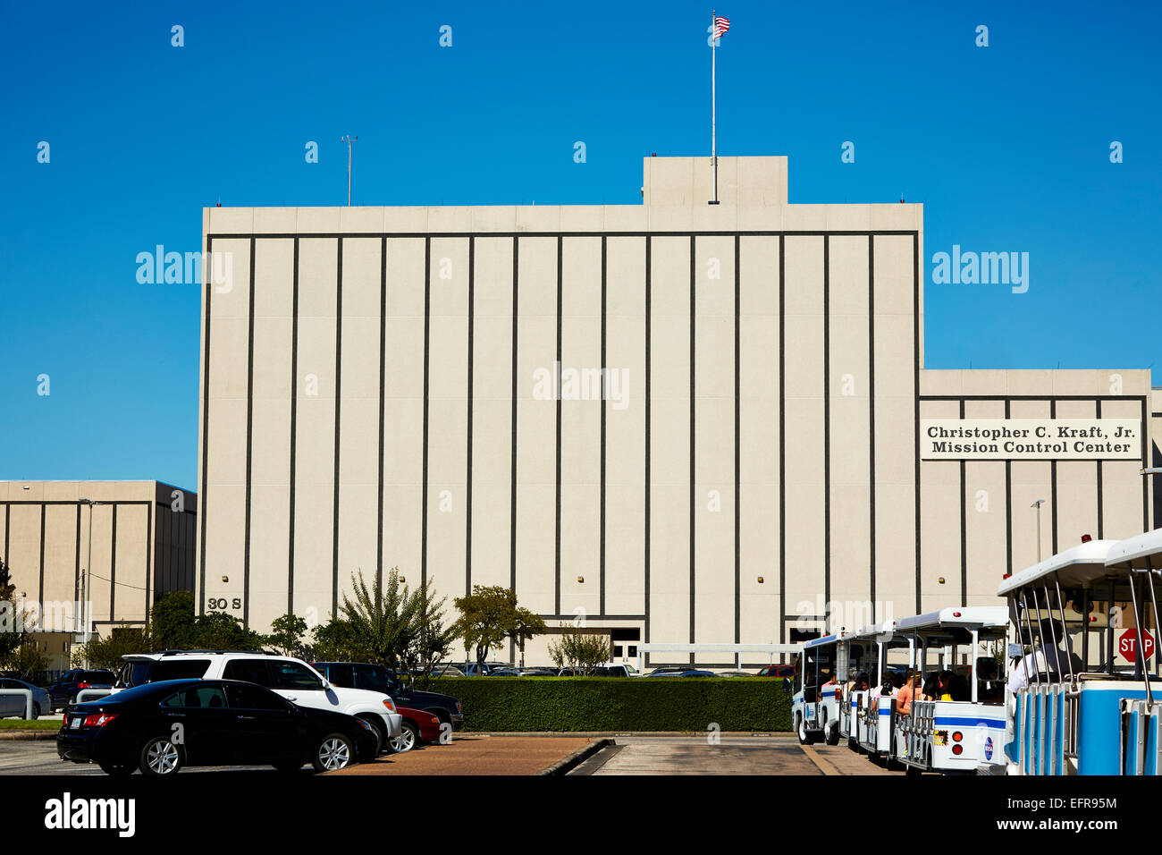Tour buses in front of the Mission Control building at the Johnson Space Center, Houston. - Stock Image