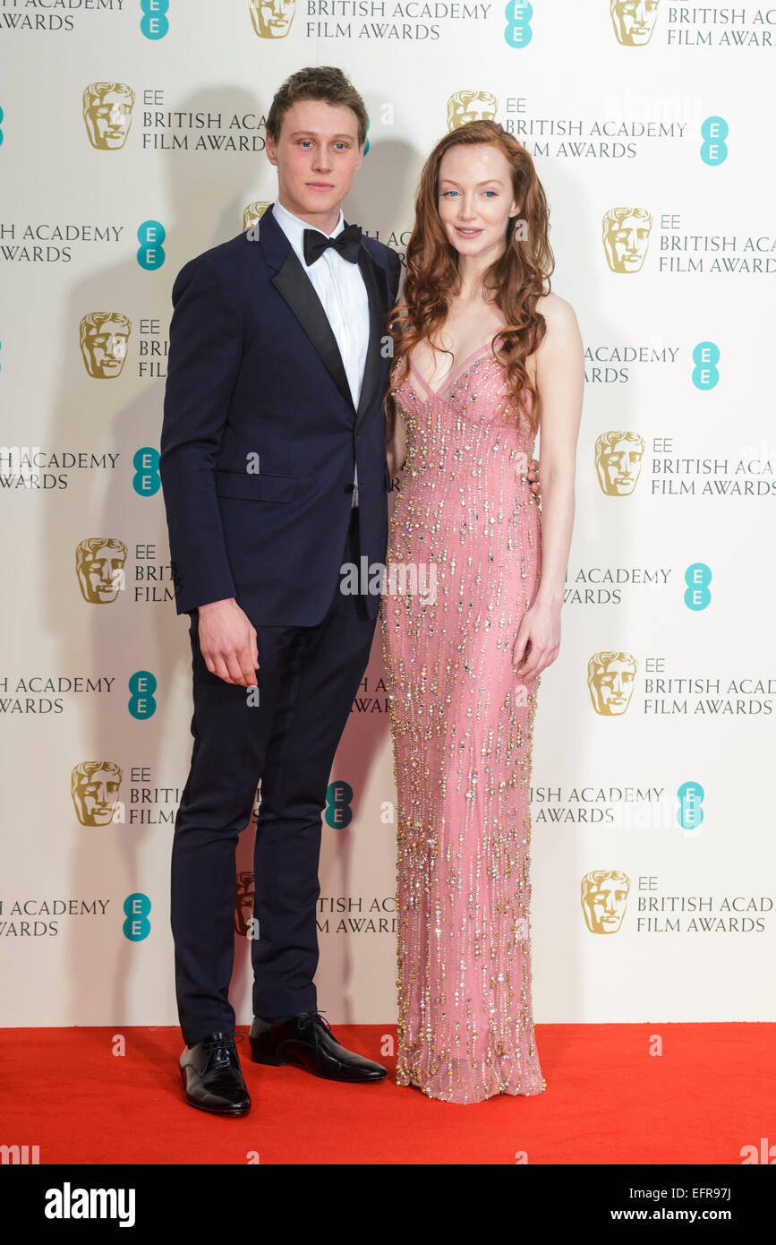 London, UK. 08th Feb, 2015. George MacKay and Olivia Grant  backstage at the EE BRITISH ACADEMY FILM AWARDS on 08/02/2015 - Stock Image