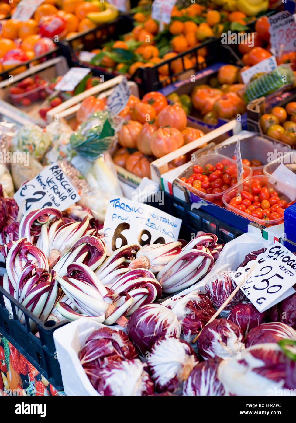 A market stall laden with fresh vegetables at the Rialto Food market. - Stock Image
