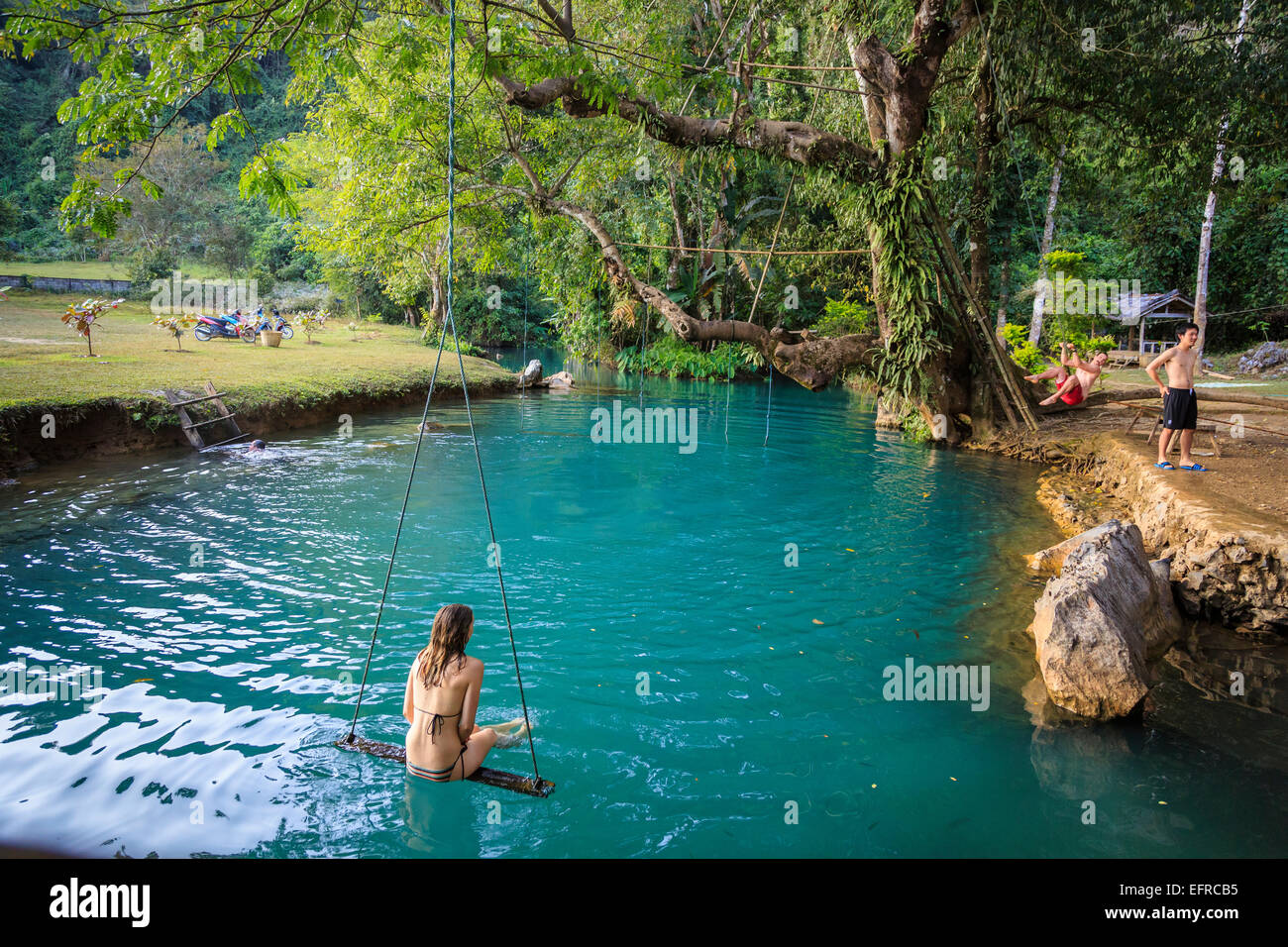 Woman On A Swing In The Blue Lagoon Vang Vieng Laos Stock Photo Alamy