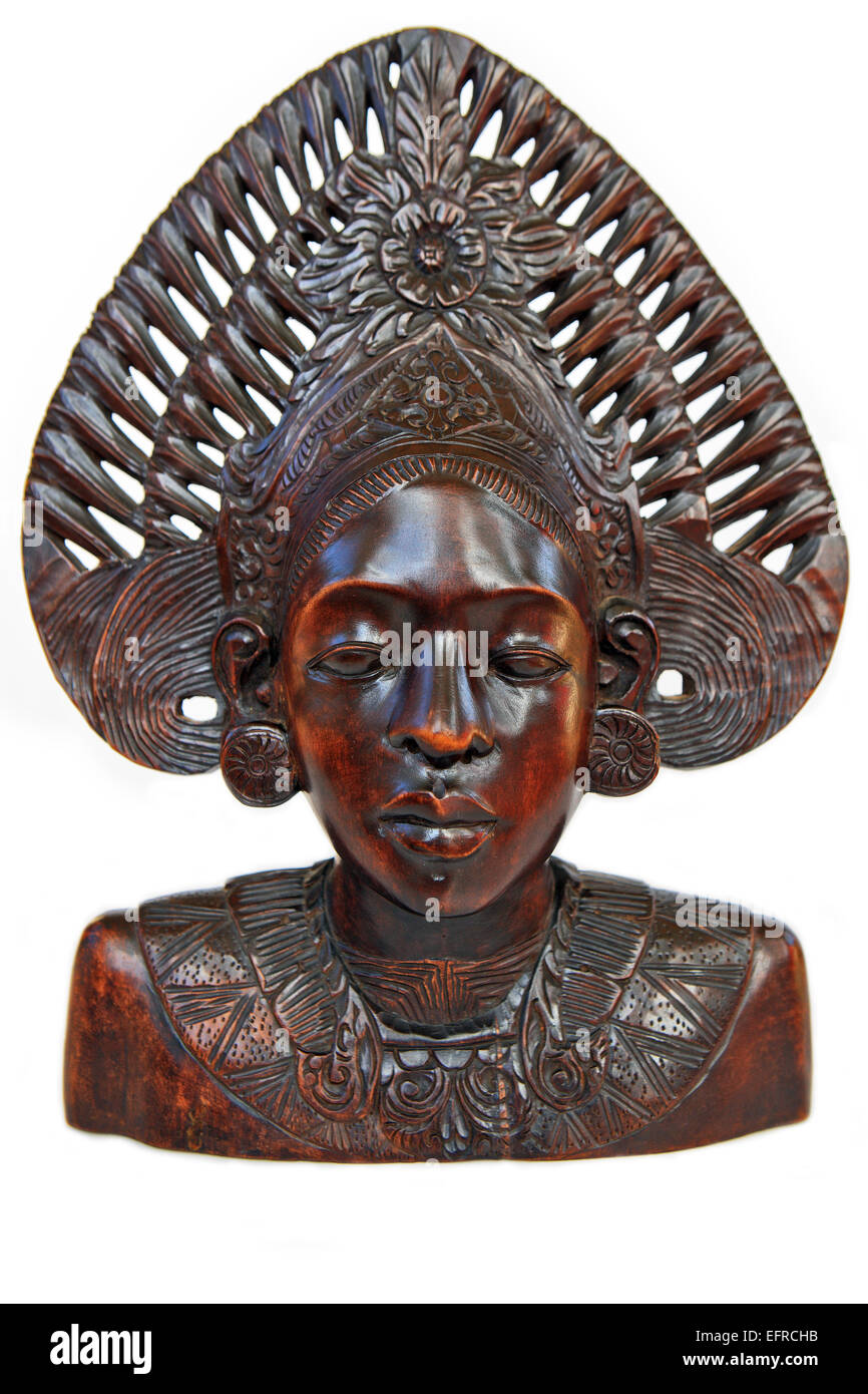 Wooden carving of African woman on a white background - Stock Image
