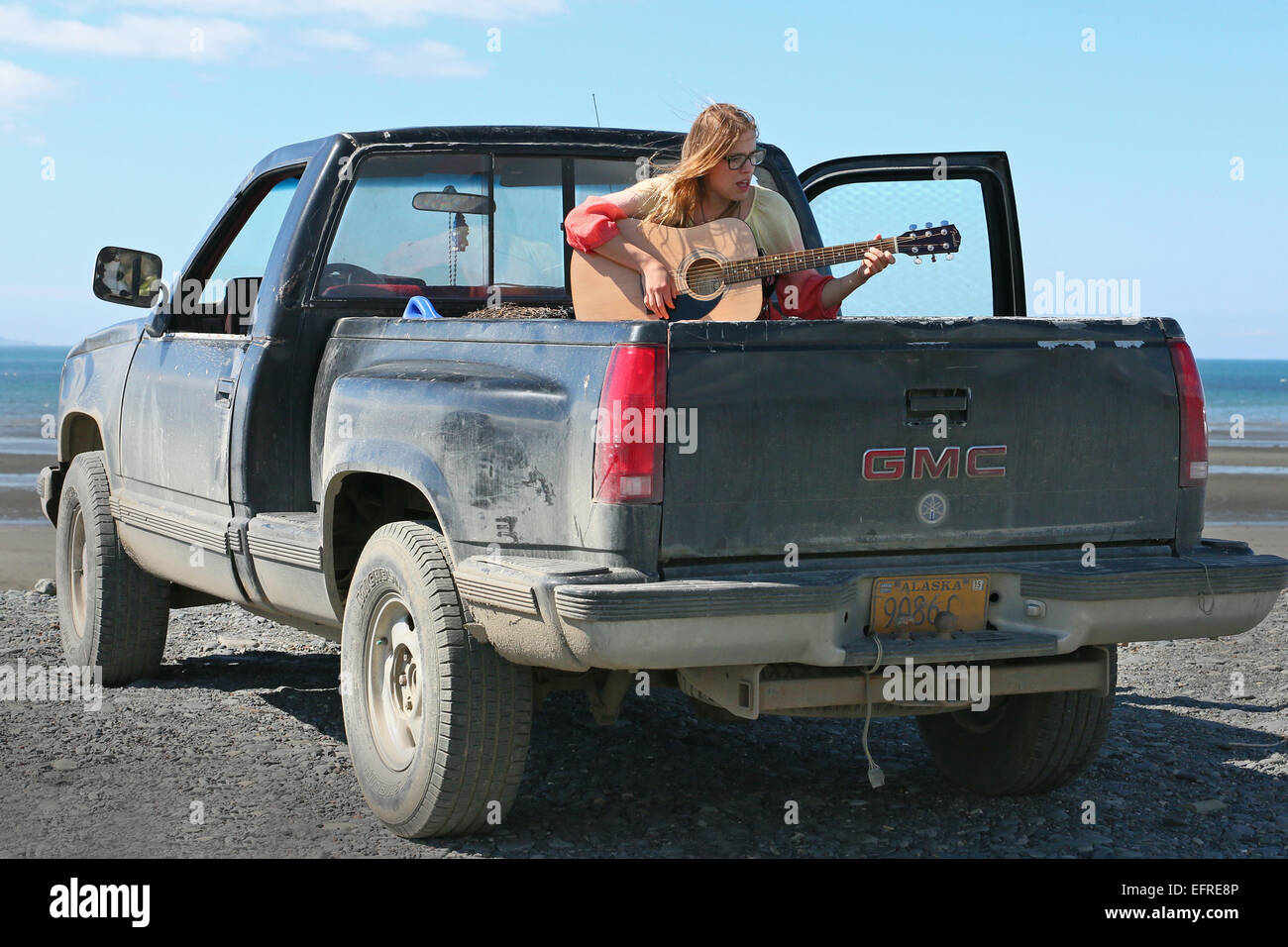Bed Of A Truck >> Young Lady Playing Her Guitar Sitting On The Bed Of A Truck In Homer