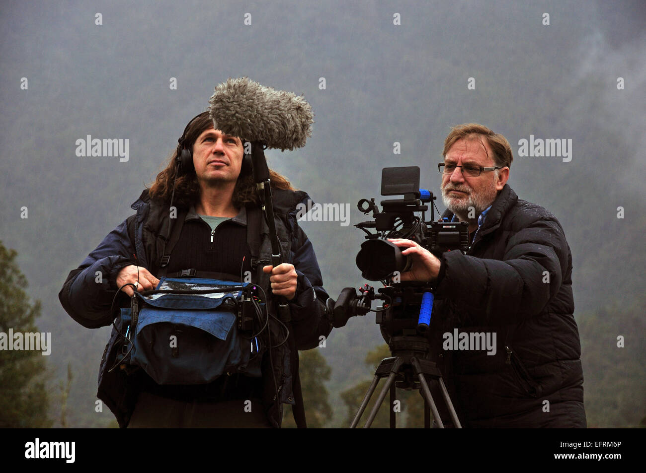 Cameraman and sound recordist at work on the West Coast, New Zealand - Stock Image