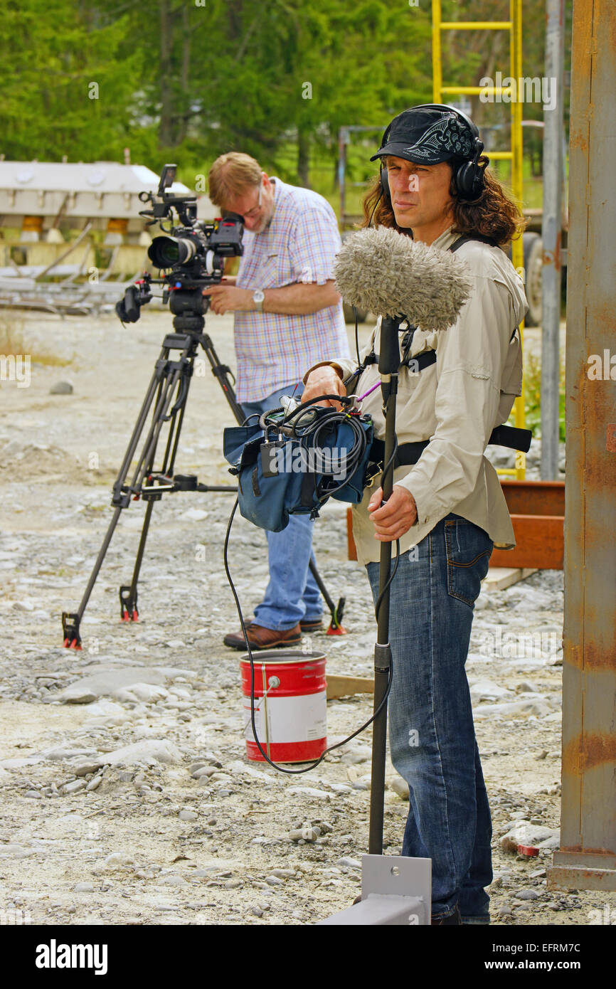 A documentary cameraman and his sound recordist at work on location - Stock Image