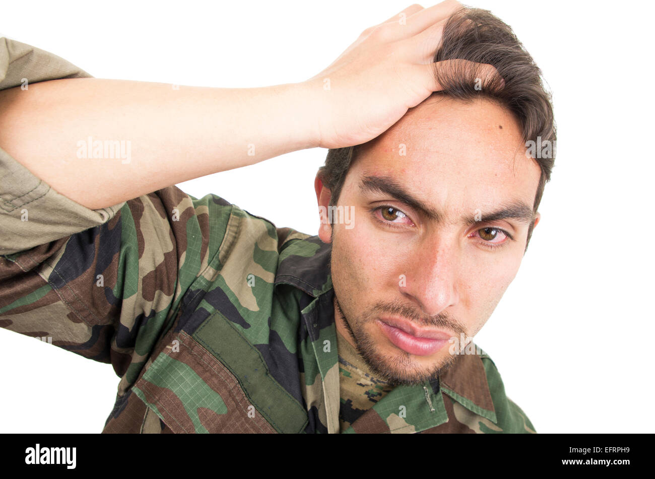 distraught military soldier veteran ptsd with teary eyes - Stock Image