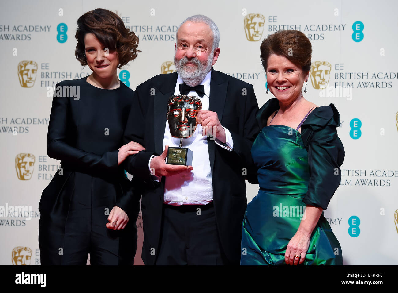 Sally Hawkins, Imelda Staunton and Mike Leigh at the EE British Academy Film Awards at The Royal Opera House on - Stock Image