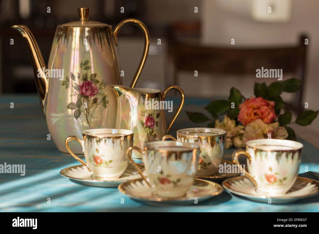 Vintage Tea Cups And Teapot On Old Wooden Table Stock