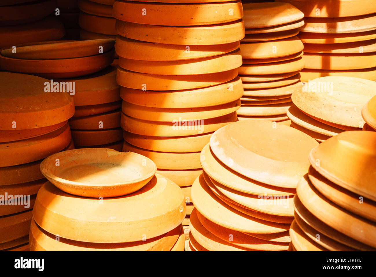 a bunch of terra-cotta flower pot saucers - Stock Image