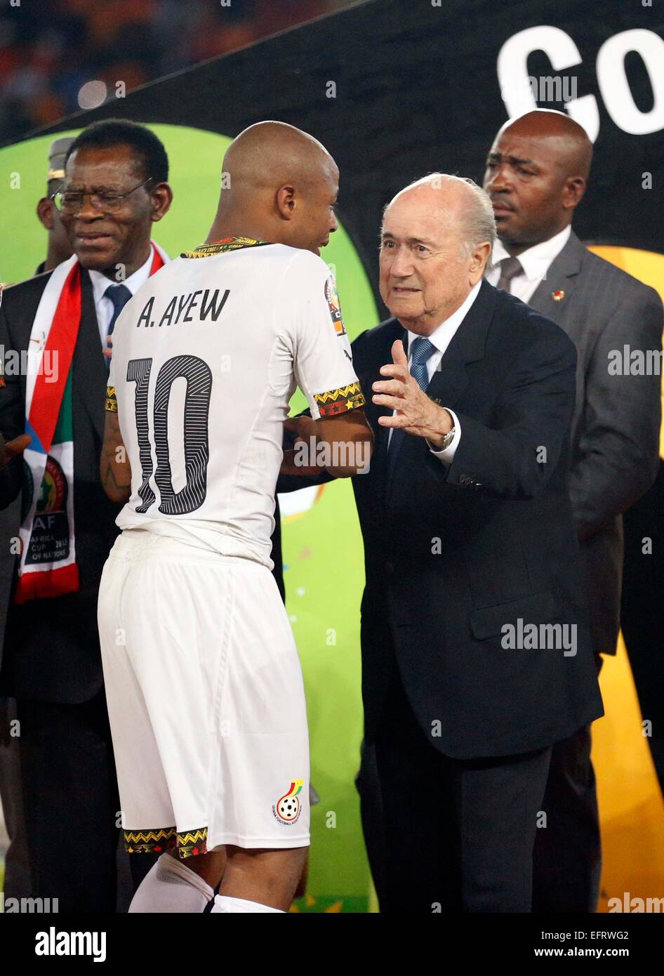 Fifa President Sepp Blatter consoles Ghana Captain Andre Ayew after being defeated by Ivory Coast during their Africa - Stock Image