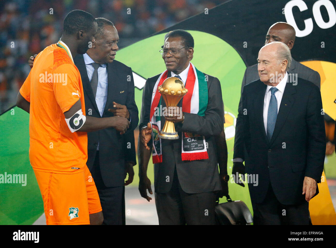 Equatorial Guinea President Teodoro Obiang Nguema Mbasogo (C) and Fifa President Sepp Blatter (R  presents a trophy - Stock Image