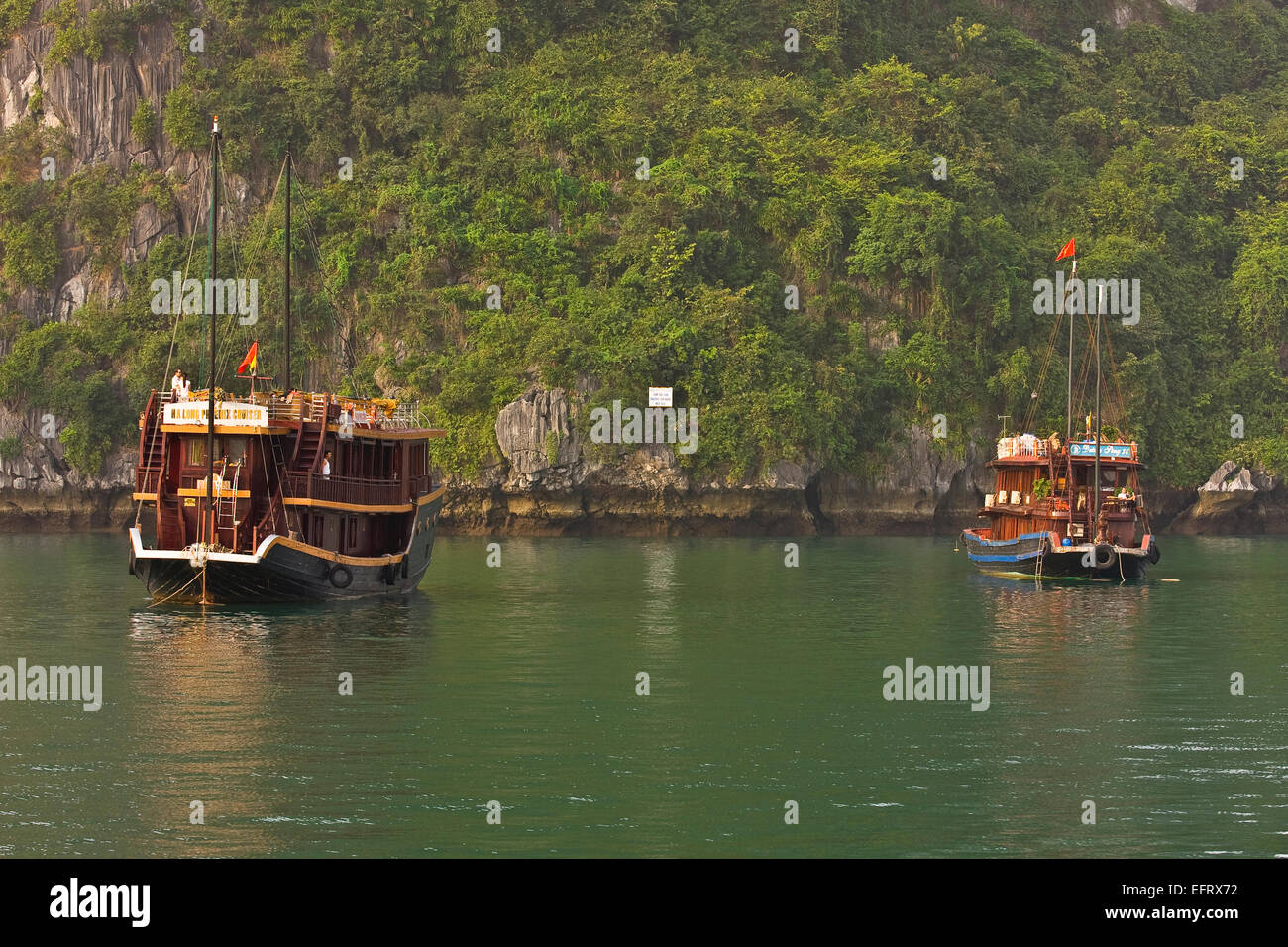 Traditional Tourist Sailing Junk Halong Bay Vietnam - Stock Image