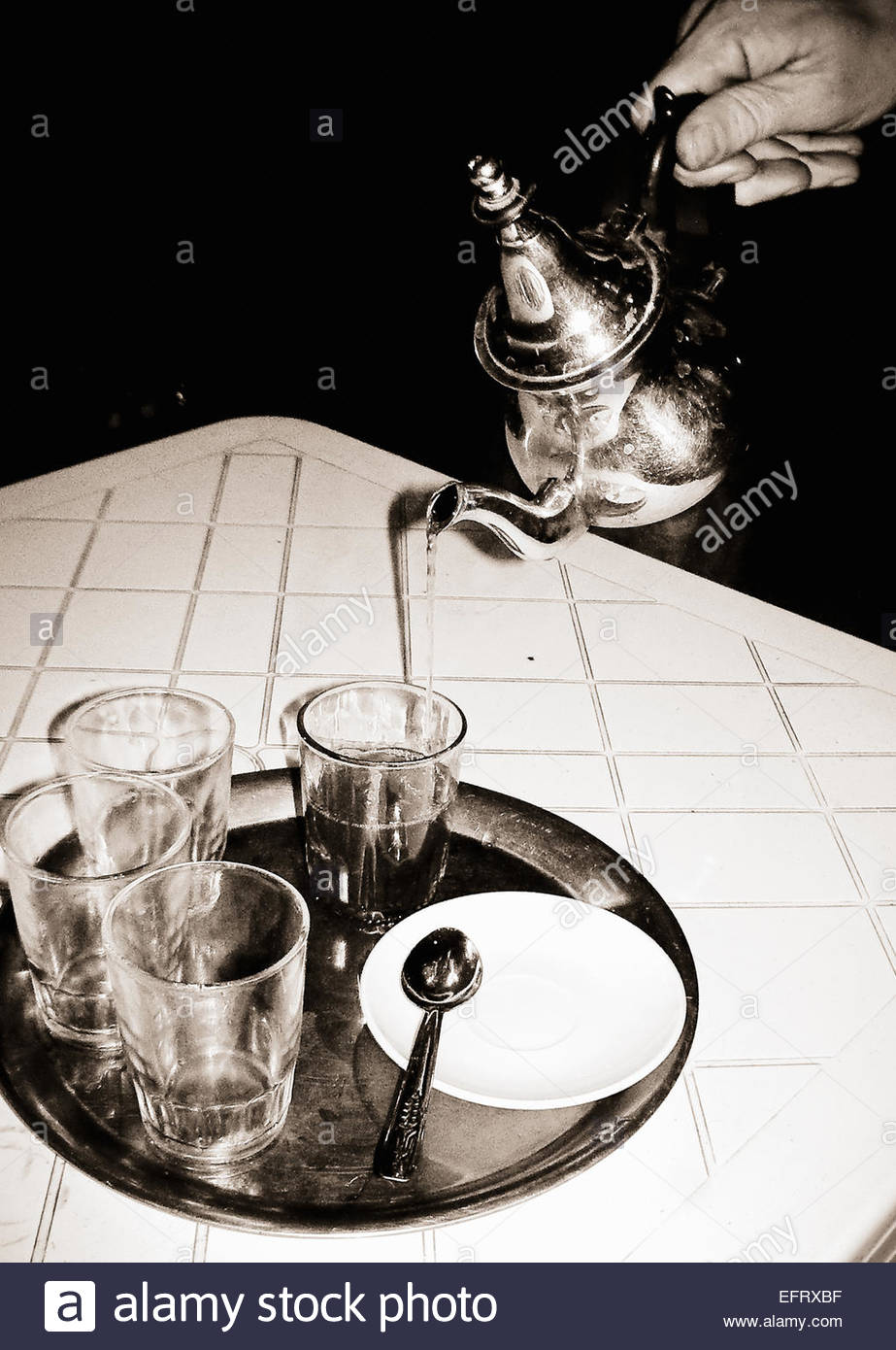 Arabic Mint Tea Poured From Silver Teapot Into Glass Restaurant Food And Drink Western Sahara Spanish Sahara Sahara - Stock Image