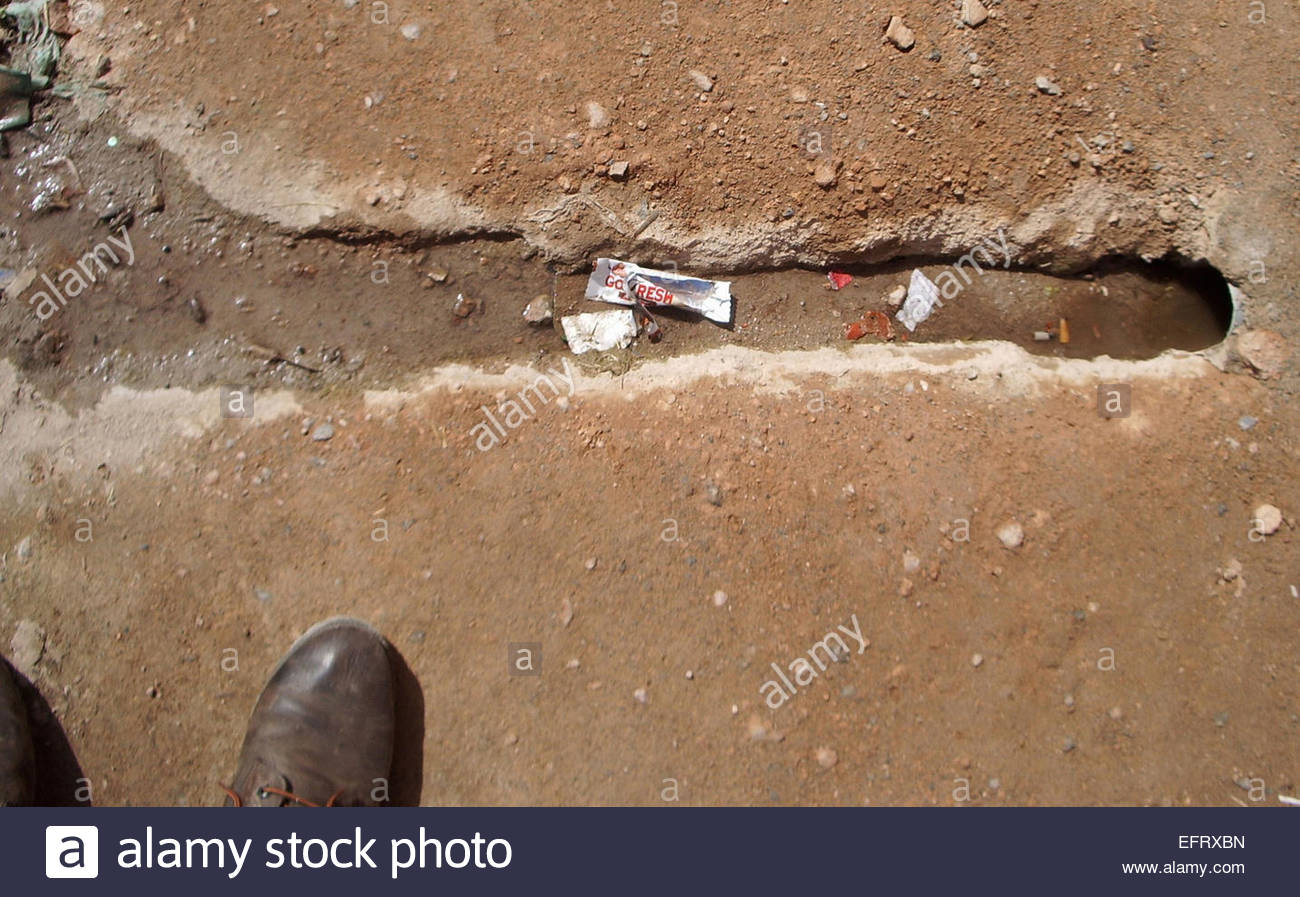 Toilet Without Plumbing .. Flows From Home Into The Dirt Street Outside Spanish Western Sahara Occupied By Morocco - Stock Image