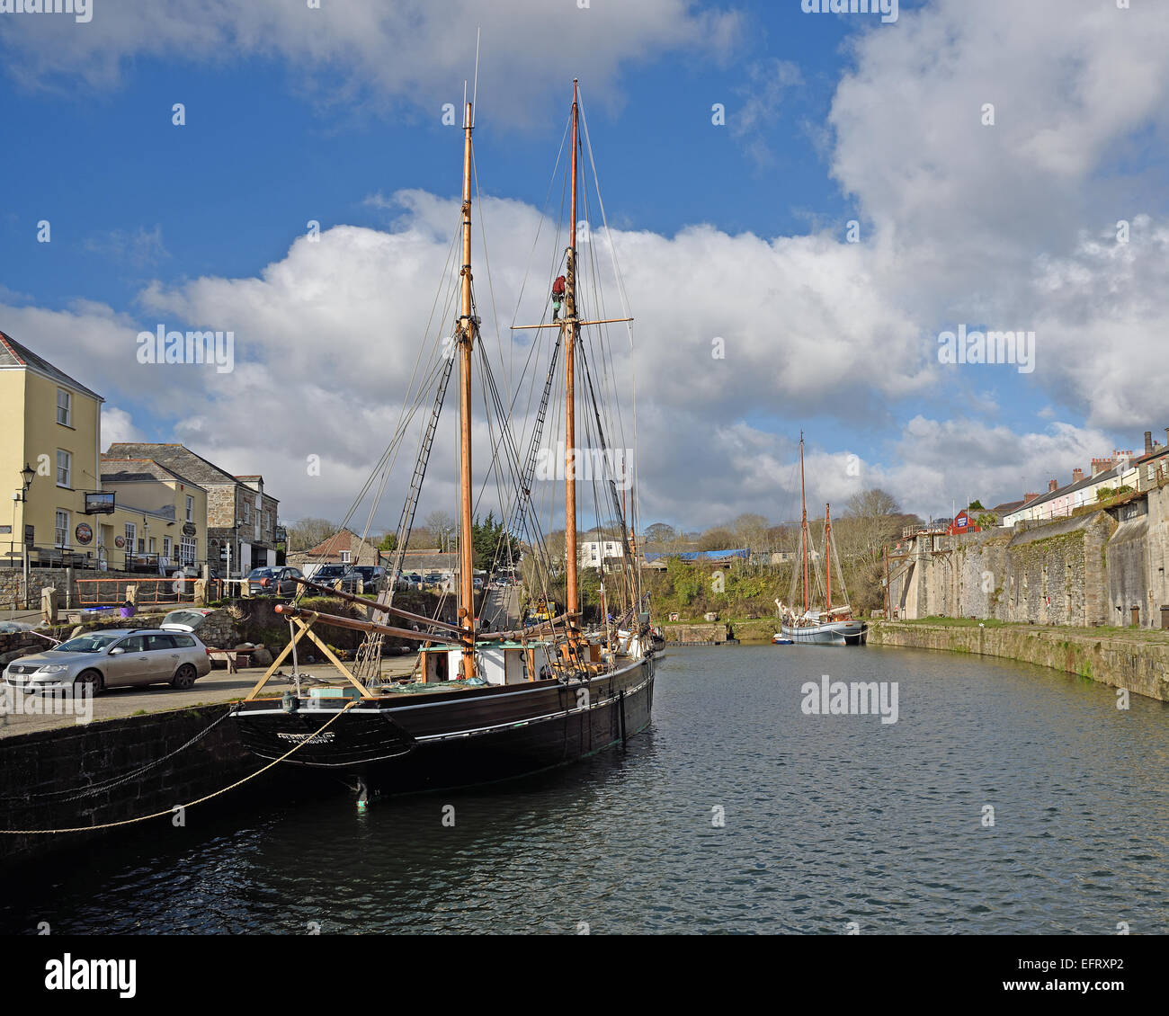 Bessie Ellen, a wooden coasting ketch at Charlestown, Cornwall, UK.  The ketch is used for sailing based holidays. - Stock Image