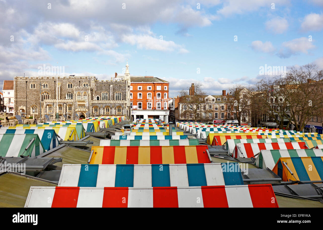 A view across the colourful market stall rooftops in the City centre of Norwich, Norfolk, England, United Kingdom. - Stock Image