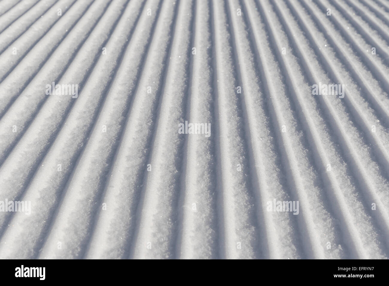 Skiing background - fresh snow on ski slope in the dolomites Stock Photo