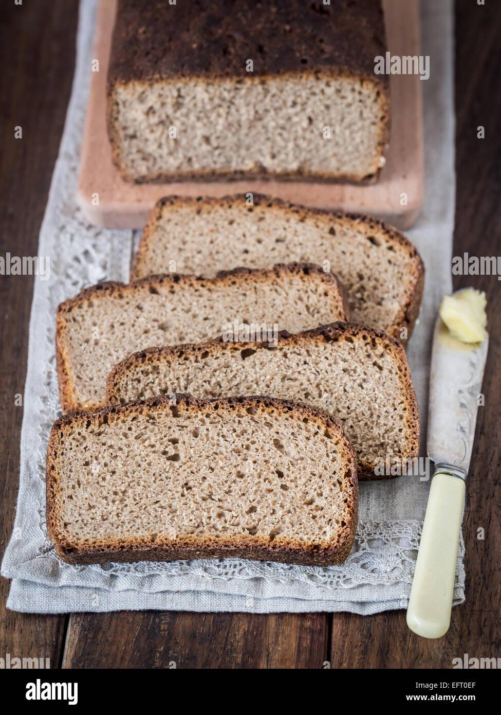 Homemade whole grain rye sourdough bread, sliced. - Stock Image