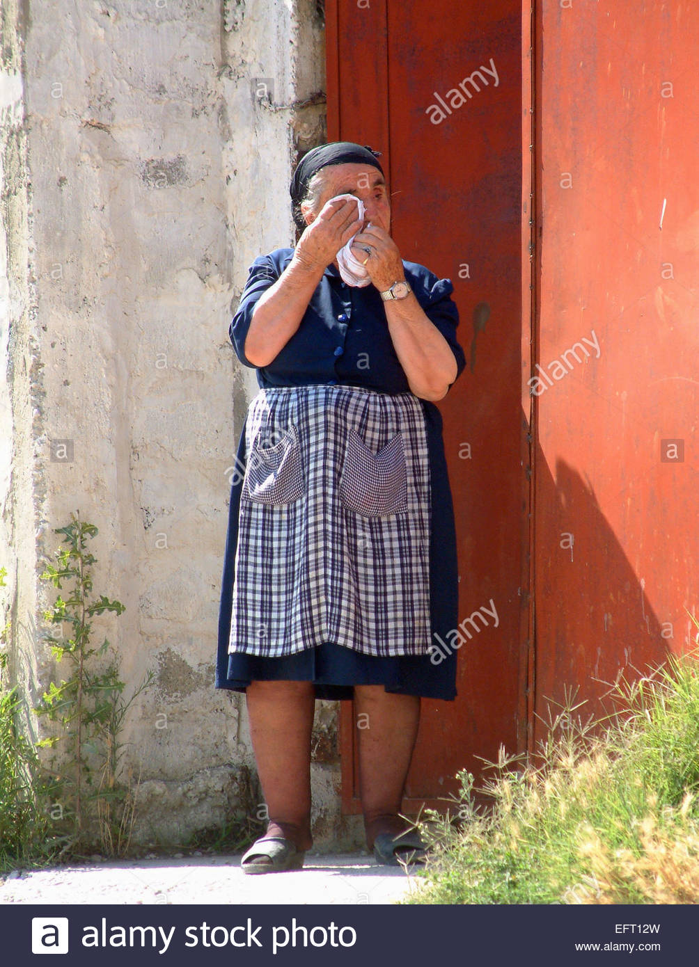 Elderly Woman Standing Outside Home Door Entrance Albania - Republic Of Albania Europe 2004 People Person Full Length - Stock Image