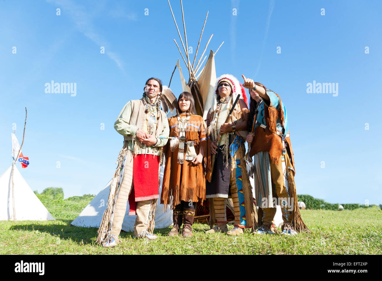 Group of North American Indians about a wigwam - Stock Image