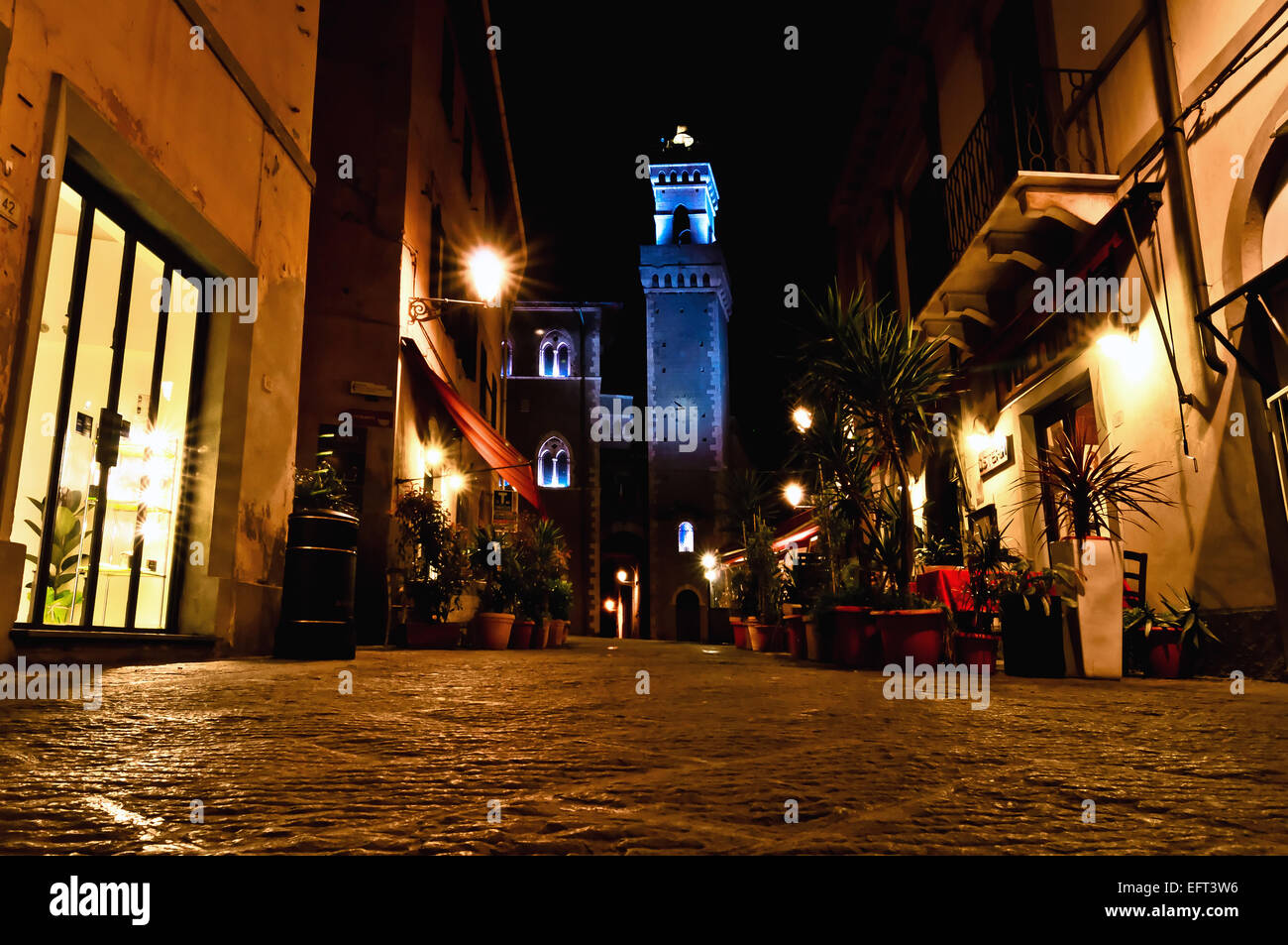 night view of downtown with enlightened Town Hall in Piombino Stock Photo