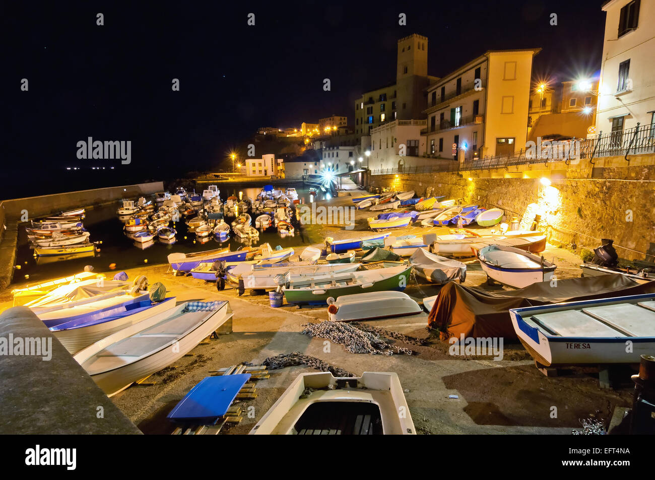 Piombino, Italy - April 17, 2013: night view of ancient downtown port in Piombino, Italy. Piombino historical urban - Stock Image