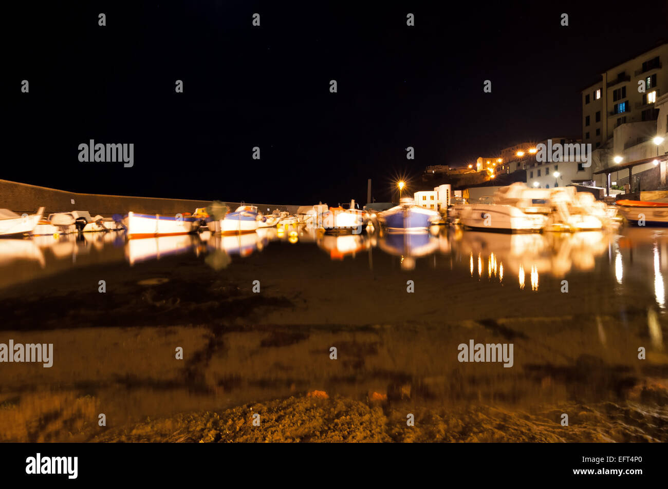 Piombino, Italy - April 17, 2013: night view of ancient downtown port in Piombino, Italy. - Stock Image