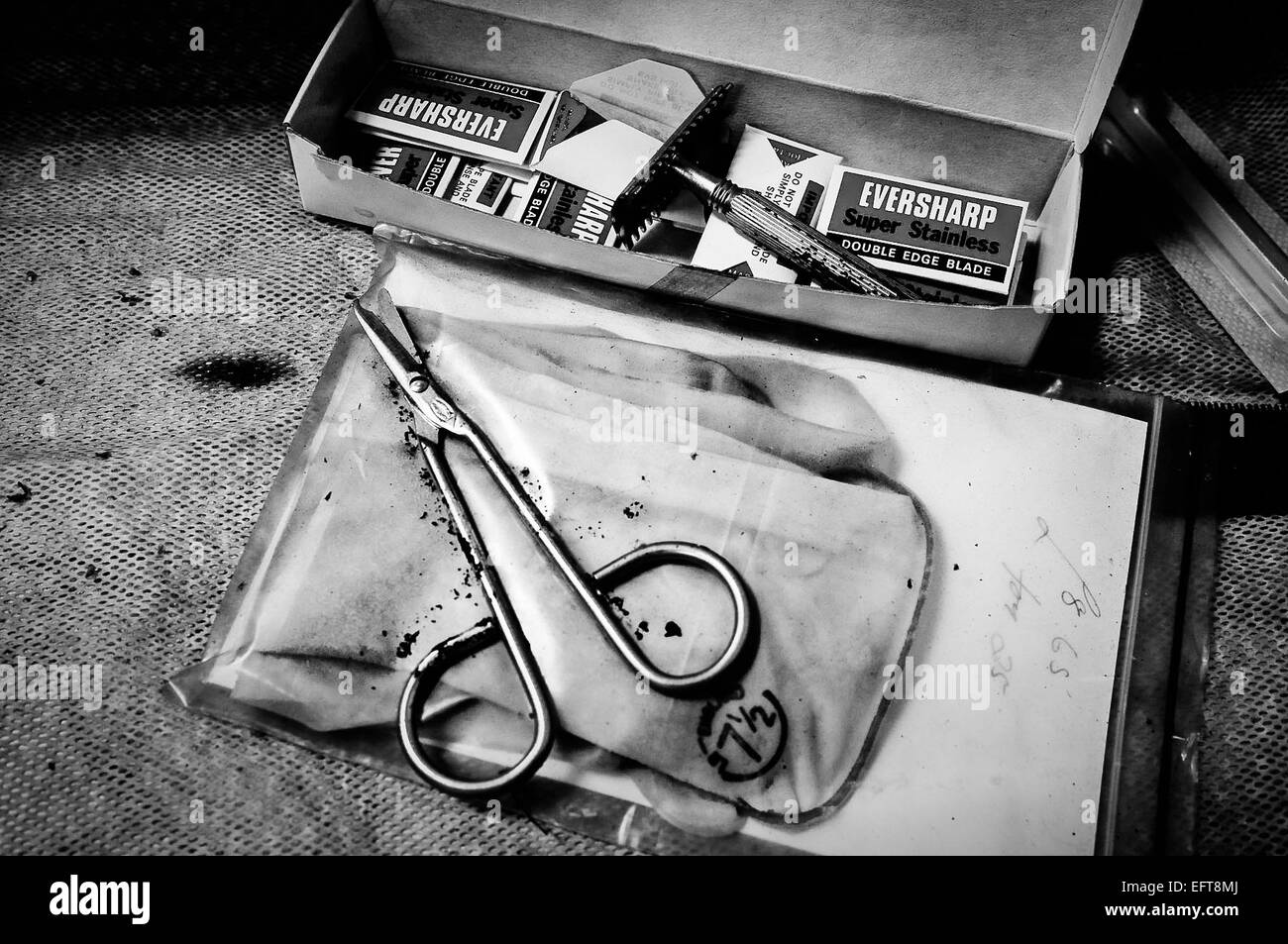 Scissors and razor blades for preparing the hair of bodies at a mortuary. - Stock Image