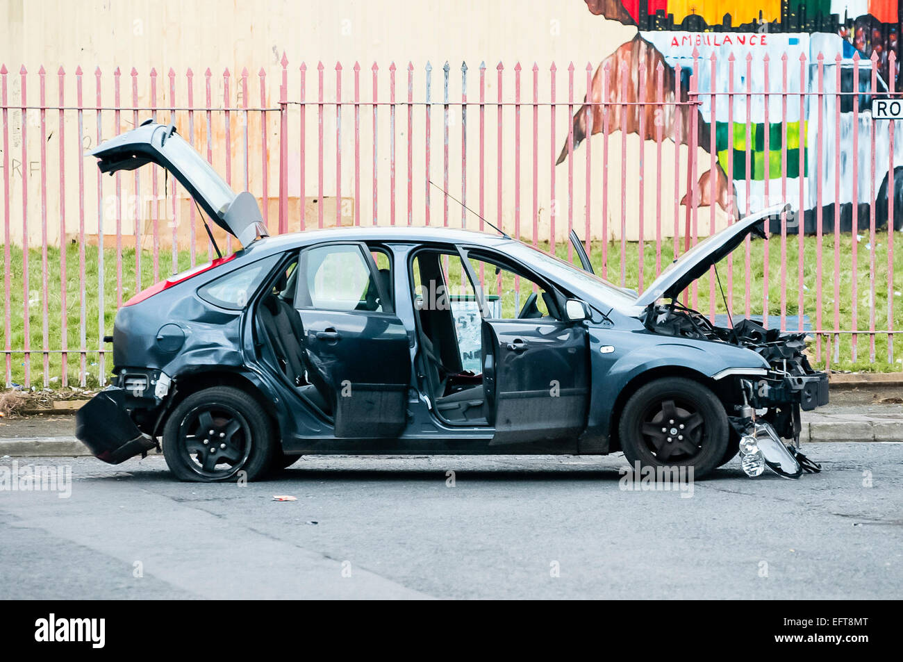 A car is destroyed by a bomb in Belfast. - Stock Image