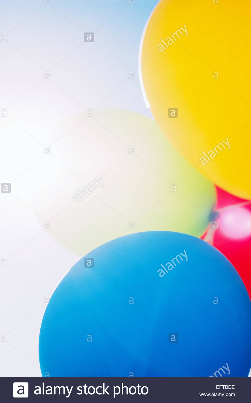 Backlit multi colored balloons - Stock Image
